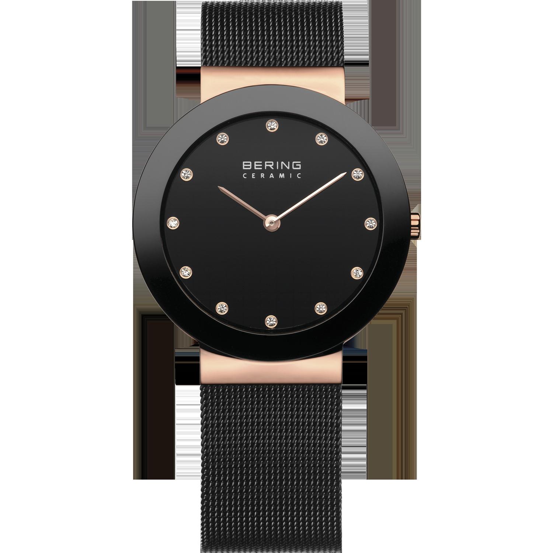 Zwartgouden horloge Bering ceramic, zwarte lijst, gouden details en Swarovski kristallen als cijfers. bandje begint goud en is dan zwart gevlochten metaal.