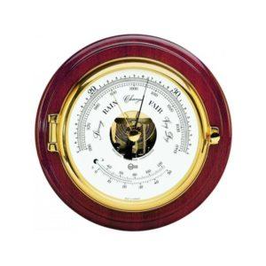 ronde barometer met thermometer. mahoniehout en messing detail, glazen patrijspoort. luxe lettertypes.