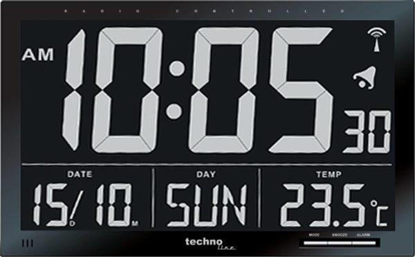 digitale klok vooraanzicht zwart met witte cijfers en letters.