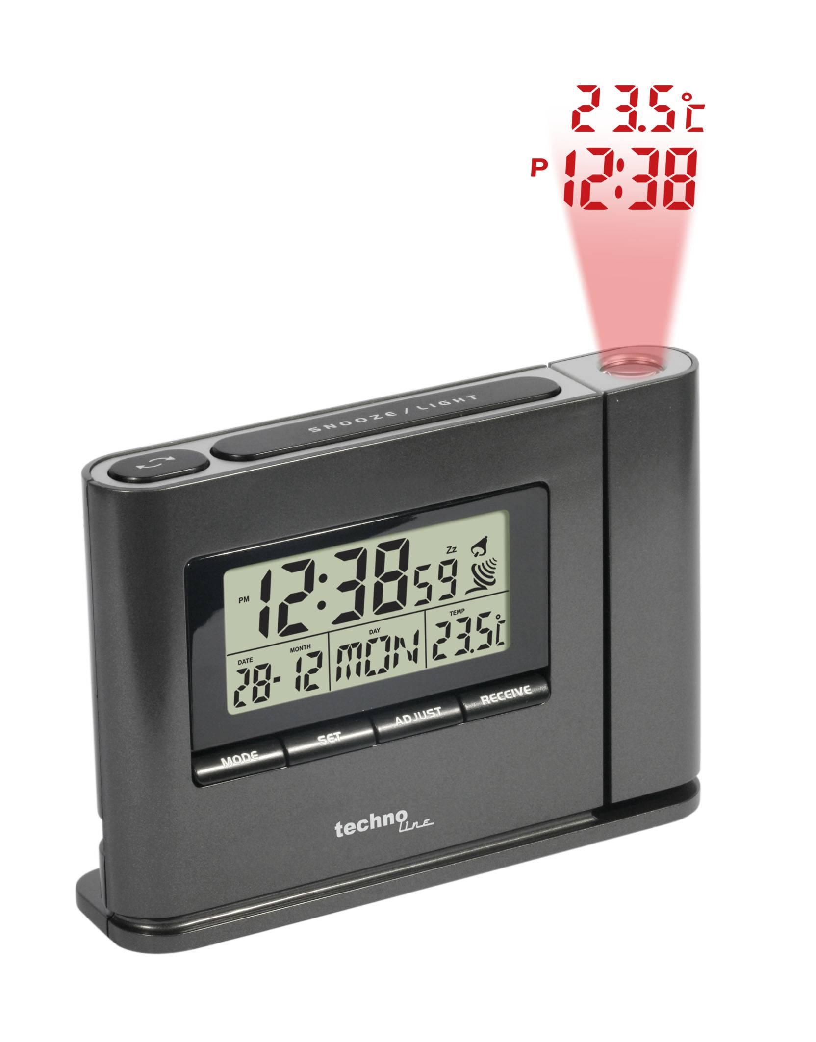zwarte projectiewekker van Techno Line met de tijd, datum,dag en temperatuur op het scherm. Knoppen met snooze, mode,set, adjust, receive. de projectie laat de tijd en temperatuur zien.