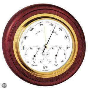 ronde barometer met mahonie en messing lijst.